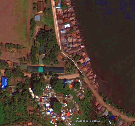 This fishing village is one of many in line for a direct hit from Bopha's 275kph winds tomorrow. Photo from Google Earth today 3/12/2012 . Notice the houses on waterfront! Google doesn't name the village , its near Boston, beside Cateel, Bayan ng Cateel, Mindanao, and not far from Lligan city, which was devastated last yearSuper-typhoons can only form over 30C water.. Climate Change is directly to blame. Climate Criminals of the Oil Companies sit back in total luxury while their victims in Cateel Bay face annihalation. As they become more common, climate related disasters may allow prosecution of the big Oil Companies, as they could be sued for billions for dumping CO2 in the air for profit, with clean alternatives available.