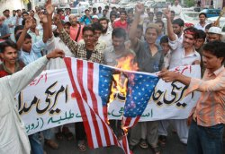 Pakistani protesters burn a U.S. flag to condemn the U.S. strikes in Pakistani tribal areas along Afghanistan border, during a rally in Karachi, Pakistan on Tuesday, Sept 23, 2008. (AP Photo/Shakil Adil)