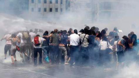 Riot police use tear gas to disperse the crowd during an anti-government protest at Taksim Square in central Istanbul