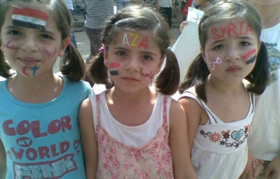 Young girls take part in a demonstration against Syria's President Bashar al-Assad  in Amude September 30, 2011.