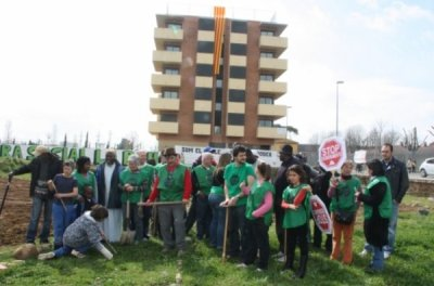 community gardens begin in front of the abandoned new block of flats, occupied with and for evicted families in Salt