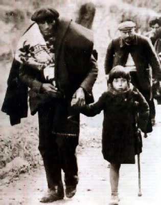 Amadeo Gracia lost a leg to Hitler's bombs, His mum and brothers and sisters died horribly. His dad Mariano (left) carries the Republiucan flag.