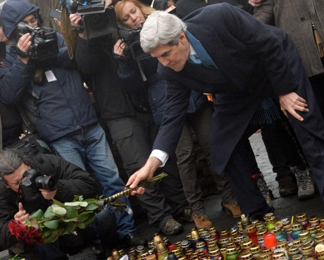 US threatens Russia for illegal invasion after illegfally invading Iraq with over half a miullion deaths. Kerry, the vulture of the IMF and World bank lays hypocritical flowers for murdered demonstrators.