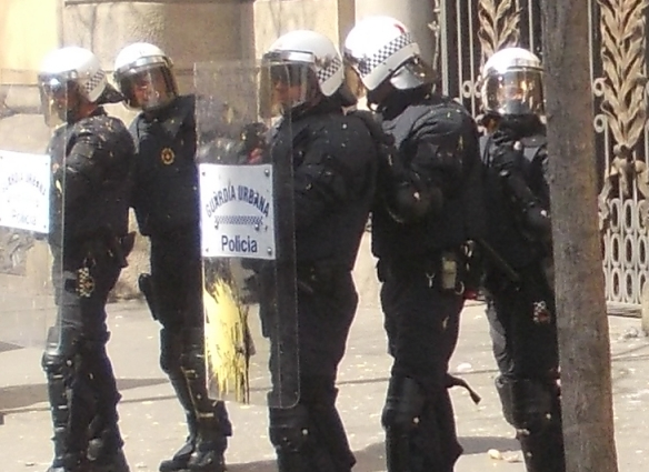 suddenly a group of masked women began paint bombing the riot police