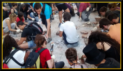 demonstrators prepare bricks to rebuild Can Vies 30 May