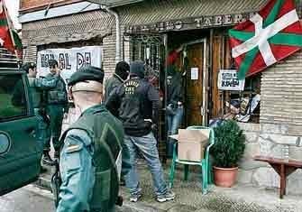Legal state terrorists raid a taverna