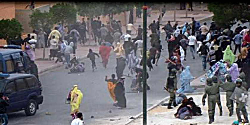 photo freon rooftop by Equipe Media shows Moroccan police attacking women when dispersing Saharawi demo.