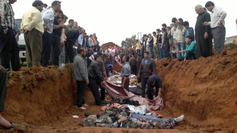 This citizen journalist image obtained by the Associated Press on Friday, April 6, 2012, shows a mass burial of people allegedly killed in recent shelling in Taftanaz, Syria. (AP Photo) THE ASSOCIATED PRESS CANNOT INDEPENDENTLY VERIFY THE CONTENT, DATE, LOCATION OR AUTHENTICITY OF THIS MATERIAL