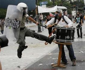 Athens cop attacks drum