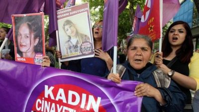 "CORRECTING INFO Women hold a banner reading ""Stop Killing Women"" and pictures of women killed during a protest to denounce violence against women in Turkey on May 11, 2013 in Ankara. At least 26 women and three children have been killed in Turkey as a result of domestic violence during the first two months of 2013, officials said on March 16, 2013. AFP PHOTO / ADEM ALTAN (Photo credit should read ADEM ALTAN/AFP/Getty Images)"