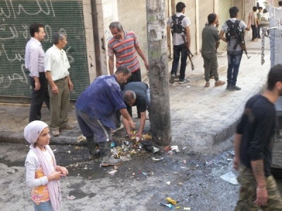 the people of Sheikh Maksoud in Aleppo are conducting a campaign volunteer cleanup in the neighborhood