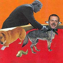 Best in Show collage by Michael Dickinson showing Turkish Prime Minister Tayyip Erdoğan as a dog given a rosette by US President George Bush