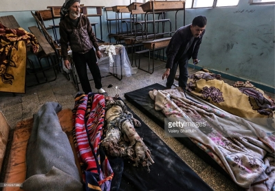 Covering dead bodies with blankets after a mortar attack on Aleppo's Sheikh Maqsoud neighbourhood