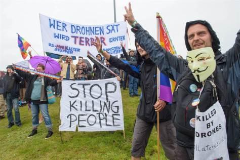 160611-ramstein-germany-protesters-1120a_66f2e8635e817ba6dacb7dc8cacf86ba.nbcnews-ux-2880-1000