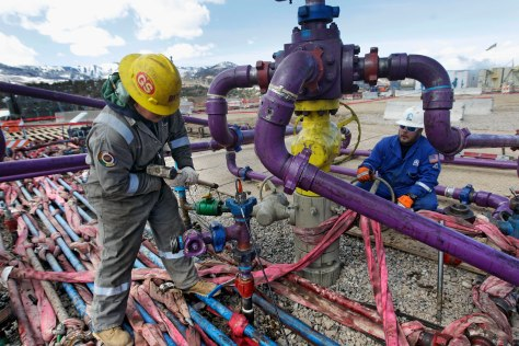 FILE - In this March 29, 2013, file photo, workers tend to a well head during a hydraulic fracturing operation outside Rifle, in western Colorado. Two new rules intended to ease tensions over fracking in Colorado will have limited impact, affecting only about 1 percent of the drilling in the state, according to an analysis by state regulators. The Colorado Oil and Gas Conservation Commission is to hold hearings starting Monday, Nov. 16, 2015, on proposals designed to address complaints that arise as Colorado's growing suburbs and oilfields collide. (AP Photo/Brennan Linsley, File)