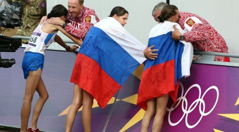 FILE - In this Aug. 11, 2012 file photo Russia coach Alexey Melnikov congratulates Olga Kaniskina, right, and Russia men's gold medalist Sergey Kirdyapkin congratulates Anisya Kirdyapkina, left, after the women's 20-kilometers race walk at the 2012 Summer Olympics in London. Russia gold-medalist Elena Lashmanova stands at center. Track and field's world governing body is meeting Friday, June 17, 2016 to decide whether to allow Russian track and field athletes to compete in the Rio de Janeiro Olympics. The IAAF's ruling council convened in Vienna on Friday to consider whether to uphold or lift the suspension of Russia's track and field federation. (AP Photo/Sergei Grits, file)