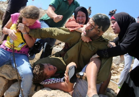 This is how 3 Palestinian women stopped an Israeli soldier from arresting a boy. 1000's are held indefinitely without trial in so-called 'Administrative Detention'.