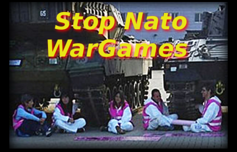 Anti Nato protestors chain themselves under war game tanks, Spain 2016.