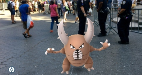 Wyatt Burnett, 22, Staten Island, student,, Alexis Gines, 26, a real estate agent, Katherine Hulit, 32, Brooklyn, actress, catches a Pinsir Pokemon in Union Square Monday, July 11, 2016, in New York.  Ref: SPL1317591  110716   Picture by: NY Post / Splash News Splash News and Pictures Los Angeles:310-821-2666 New York:	212-619-2666 London:	870-934-2666 photodesk@splashnews.com