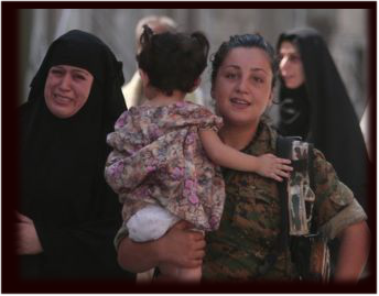 A YPJ volunteer helps rescue civilians from ISIS in Manbij.