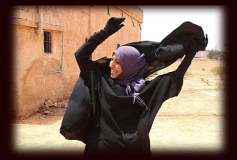 women removed and sometimes burned their burqas after ISIS defeat in Manbij