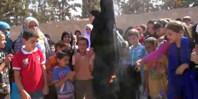 Syrian-women-burn-burkas-to-celebrate-liberation-from-Isil-in-Manbij-Syria