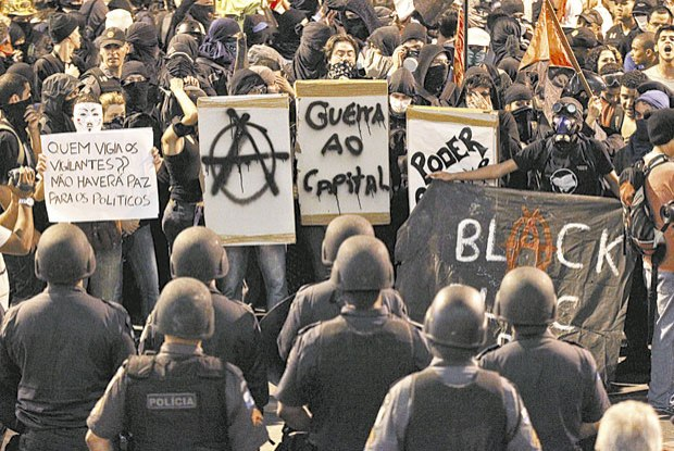 The black bloc is more about self protection, in the case of rioting small masked groups work much better