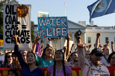 Supporters of the Standing Rock Sioux Tribe rally in opposition of the Dakota Access oil pipeline in front of the White House, Tuesday, Sept. 13, 2016, in Washington. The company developing the $3.8 billion Dakota Access pipeline says it is committed to the project, despite strong opposition and a federal order to halt construction near an American Indian reservation in North Dakota. (AP Photo/Jacquelyn Martin)