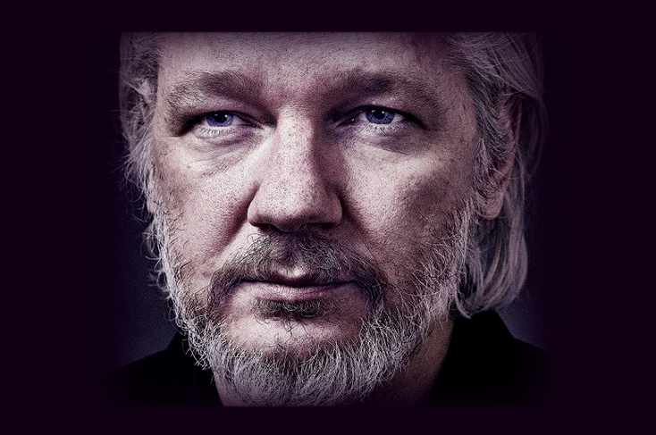 Belmarsh Prisoners get Assange out of Solitary  Assange-shows-innocence