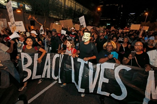 Marchers numbering nearly 1,000 take to the streets to protest against the recent fatal shootings of black men by police Friday, July 8, 2016, in Phoenix. Freeway ramps were closed and pepper spray and tear gas were used Friday night during a protest in downtown Phoenix following the killings of black men in Baton Rouge, Louisiana, and suburban St. Paul, Minnesota, at the hands of police and the deadly sniper attack on police officers in Dallas. (AP Photo/Ross D. Franklin)