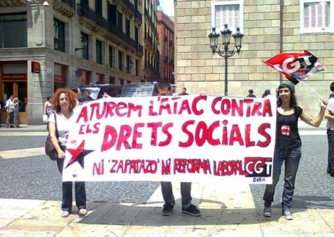 Lola is on the right.. banner<. ' Stop Attacks on Social Rights'