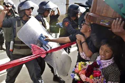 Police repression - Police repression even during funerals of the community's leaders. Source: http://bloglemu.blogspot.be/2013/10/represion-y-criminalizacion-de-las_4.html