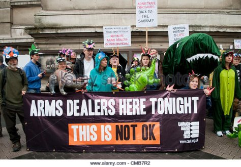 london-uk-090712-anti-arms-trade-protesters-dressed-as-dinosaurs-gather-cmb7r2