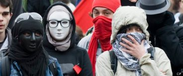 Protesters with their faces covered are shown during an anti-capitalist demonstration in Montreal, Tuesday, May 1, 2012. THE CANADIAN PRESS IMAGES/Graham Hughes