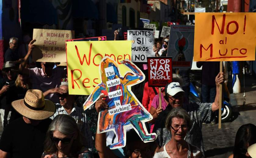 """People take part in the """"Women's March"""" in Ajijic -a city with a large community of US and Canandian nationals, mainly retired-, Jalisco state, Mexico on January 21, 2017. The rally took place in solidarity with the Women's March summoned in the United States one day after the inauguration of President Donald Trump. / AFP PHOTO / HECTOR GUERREROHECTOR GUERRERO/AFP/Getty Images NYTCREDIT: Hector Guerrero/Agence France-Presse -- Getty Images"""