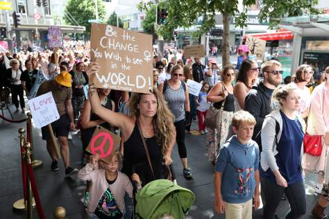 AUCKLAND, NEW ZEALAND - JANUARY 21: Thousands of people march up Queen Street on January 21, 2017 in Auckland, New Zealand. The marches in New Zealand were organised to show solidarity with those marching on Washington DC and around the world in defense of women's rights and human rights. (Photo by Fiona Goodall/Getty Images) NYTCREDIT: Fiona Goodall/Getty Images