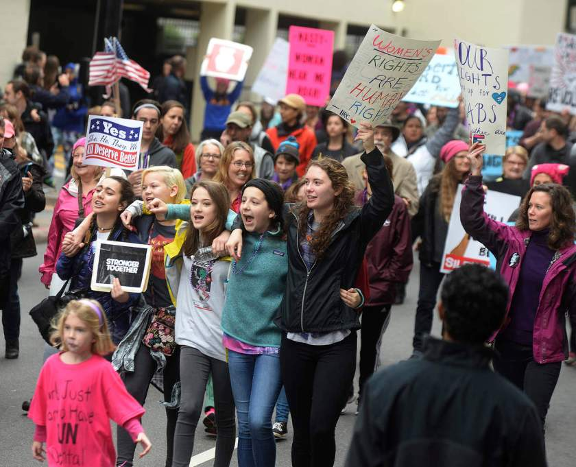 """Marchers on Church St. at Saturday's Women's March on Charlotte, N.C., which drew at least 10,000 people according to CMPD. The mile-long march was scheduled to coincide with a national demonstration Saturday, Jan. 21, 2017, in Washington, D.C., the day after Donald Trump's inauguration as president. The march started at First Ward Park, traveled down Tryon Street to 4th St. to Church St. and ended at Romare Bearden Park. """"The Women's March on Charlotte is a first step in uniting our communities and in empowering grassroots change,"""" march organizers say on the march's website. """"We will work peacefully to send a bold message to our elected leaders that women's rights are human rights."""" (Diedra Laird/The Charlotte Observer via AP) NYTCREDIT: Diedra Laird/The Charlotte Observer, via Associated Press"""