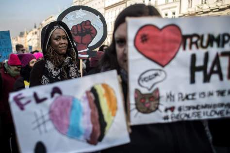 epa05738284 People hold banners as they attend 'Love Trumps Hate' rally, an official sister protest to the Women's March in Washington, in Prague, Czech Republic, 21 January 2017. Protest rallies were held in over 30 countries around the world in solidarity with the Women's March on Washington in defense of press freedom, women's and human rights following the official inauguration of Donald J. Trump as the 45th President of the United States of America in Washington, DC, USA, on 20 January 2017. EPA/MARTIN DIVISEK NYTCREDIT: Martin Divisek/European Pressphoto Agency